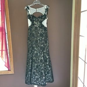 Black lace over tan sleeveless long dress